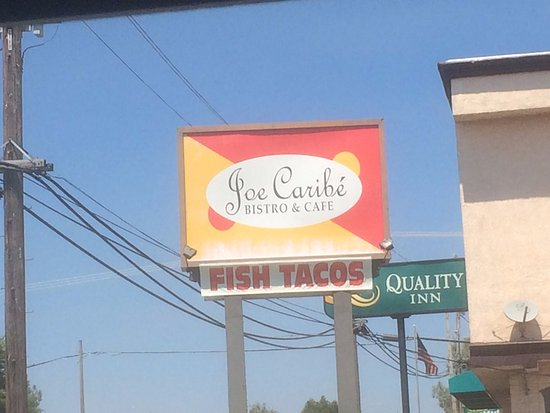 Joe Caribe Bistro and Cafe: Sign at street