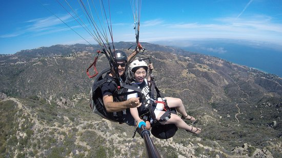 Amazing, thrilling and exiting tandem paragliding flight over Malibu!