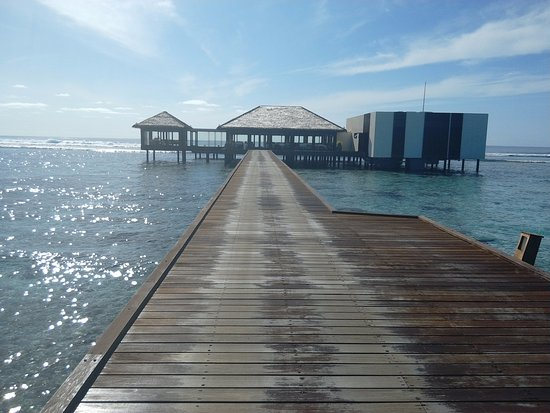 The Residence Maldives: A walk along a jetty to Falhuma restaurant , excellent service quality and whole experience surr