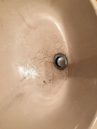 Chetola Resort at Blowing Rock: Unfortunate condition for the sink - fixtures are dated and in poor repair.