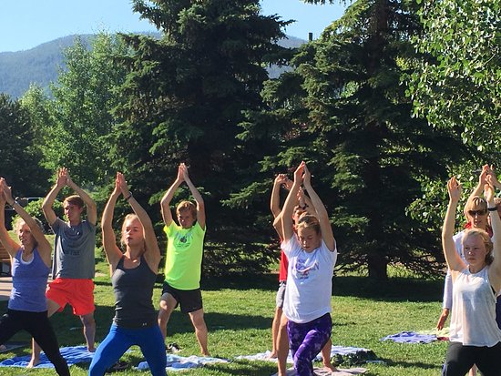 Dillon, CO: South Dakota cross country team enjoying Yoga at the Marina with Lauren Brand