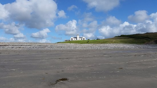 Looking up at Moy House from the beach