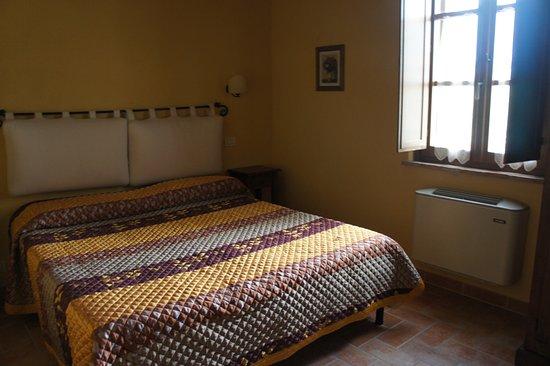 Poggio Tobruk: Спальня 2 двухкомнатного номера