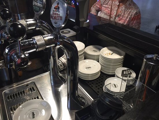 Woolsington, UK: This is the coffee preparation area. The filthy saucers are ready for service