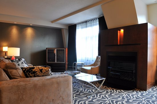 Living Room Area With Fireplace And Tv Picture Of Le Saint Sulpice