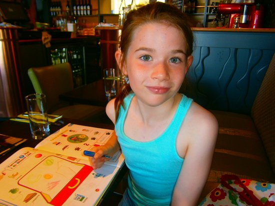 Dungarvan, Irland: doing her 'summer homework' while waiting for food.