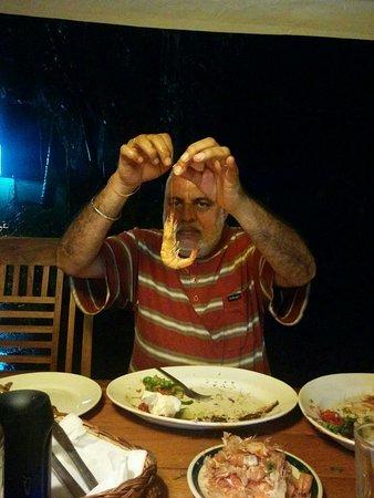 Anjuna, India: Rabindra ji devouring the fare with gusto.