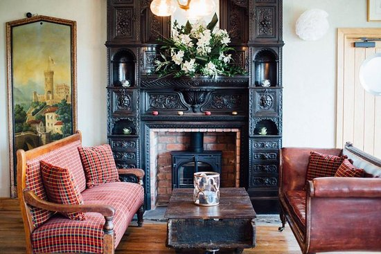 Kendal, UK: Have a seat next to our beautiful fireplace.