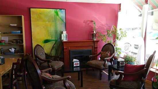 Crandleberry's : Comfy, sunny seating area with original art