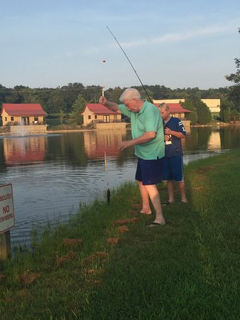 Santa's Lakeside Cottages: Grandfather catching fish