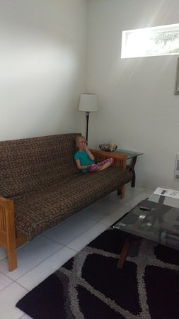 The Marinaside Resort / Palms Hotel & Condominiums: Futon in living room. Faces TV and fireplace (electric)