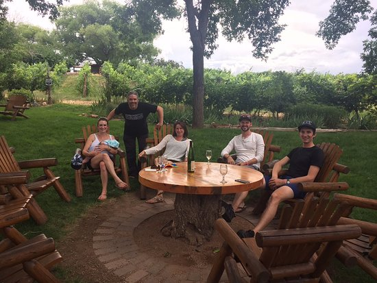 Palisade, CO: Friends enjoying a bottle of wine outside of Carlson Vineyards.