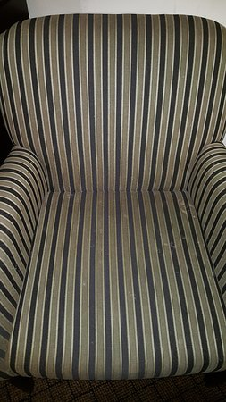 Holiday Inn Express Atlanta-Emory University Area : Stains on chair (might be hard to see because of strips, white stains on cushion near arm)