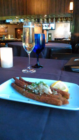 The Woodlands, TX: half order of fried asparagus with crab meat; prosecco wine; bar visible in the background