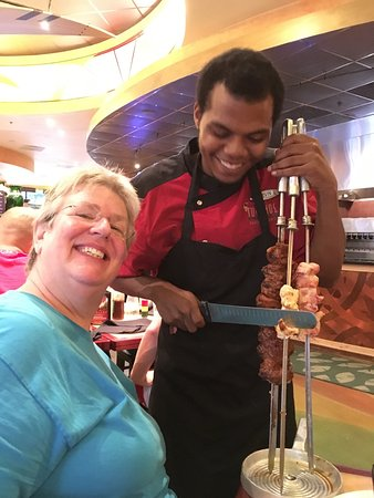 Tucanos Brazilian Grill: Have some of the skewer? Please... And Thank-you!