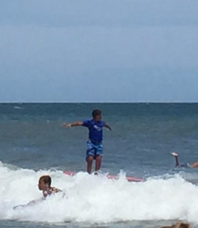 Tony Silvagni Surf School: 11 year old son riding a wave