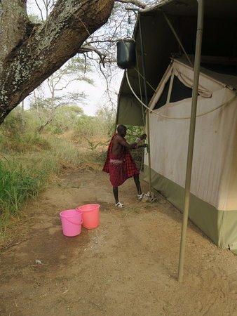 Porini Amboseli Camp : The bucket shower being prepared!
