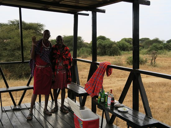 Porini Amboseli Camp : Sundowner time! An Elephant & Giraffe came to the water hole whilst sipping our G & T's within 5