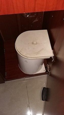 The Boathouse: Filthy bin inside the cupboard