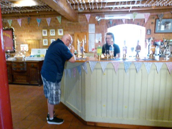 Hook Norton, UK: My brother in law trying an ale.
