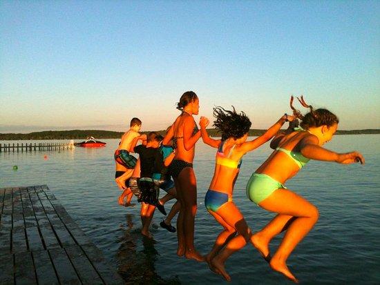 Elk Rapids, MI: Staffers jumping off the dock