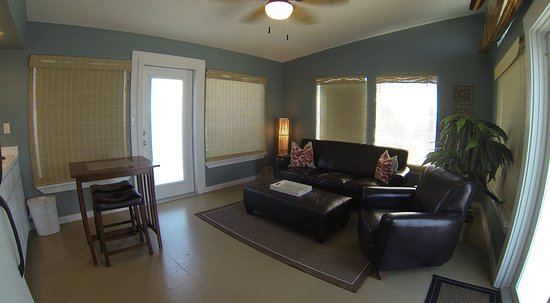 Balinese Wellness Spa and Yoga Retreat: Wide angle shot of living room in unit 6