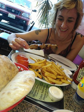 The better half enjoying a meat stick - the other meats are hidden under the chips.