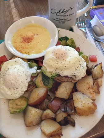 Colby's Breakfast & Lunch: Brussel Sprouts hash with crab Benedict, hollandaise on the side.