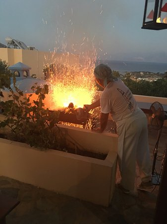 Elounda Heights Apartments and Studios: Getting the BBQ going Vangeli style!
