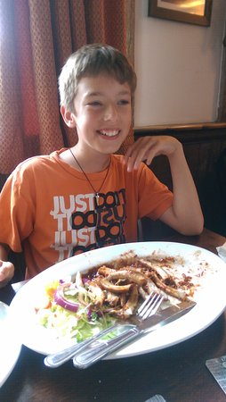 Brookland, UK : My 10 year old demolishes the ribs!