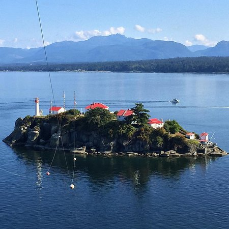 Denman Island, Canada: View of Chrome Island and the lighthouse from Boyle Point.