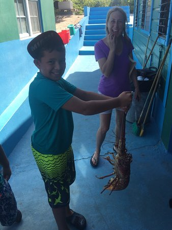 Road Town, Tortola: My son shows off a lobster at the Big Bamboo! A great place on Loblolly Beach.