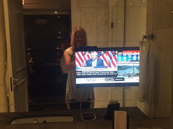 Trump International Hotel & Tower Toronto: Tv in mirror and yes, that was Trump on the news in the Trump tower! Lol