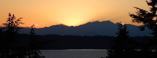 Burien, WA: Sunset behind the Olympia mountains, looking west from the cottage