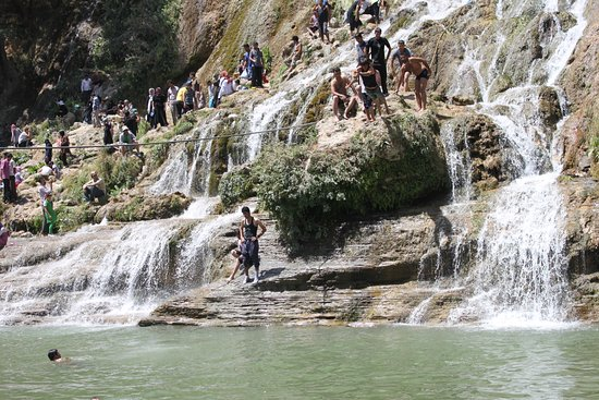 people around the waterfall - ...