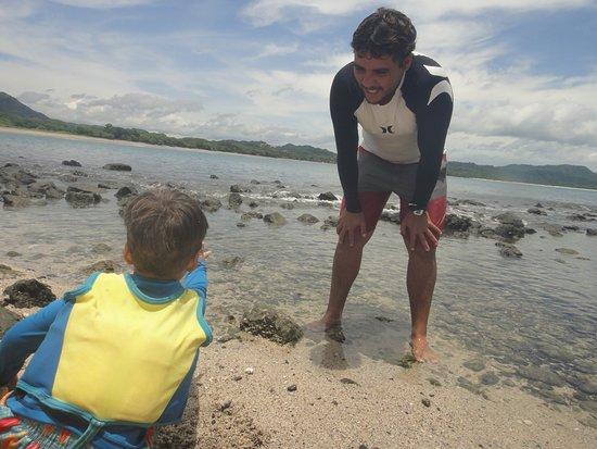 Playa Grande, Costa Rica: my son showing Marcos something!