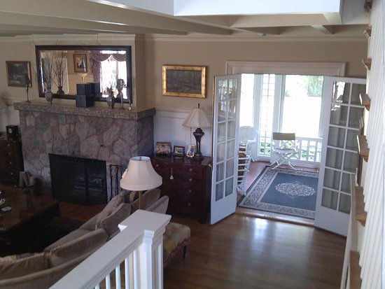 Auburn, NY: View of living room and porch from stairway.