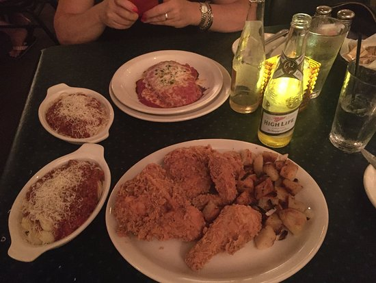 Spring Valley, Илинойс: My Italian fried chicken dinner (includes side potato, spaghetti & salad) & my wife's veal parme