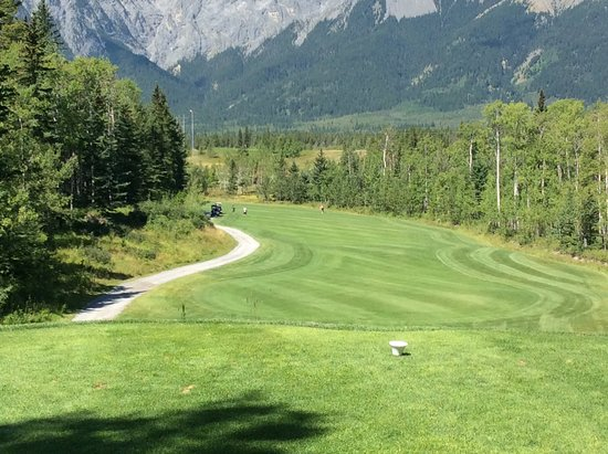 Seebe, Canada: Dogleg left, mountains in the background