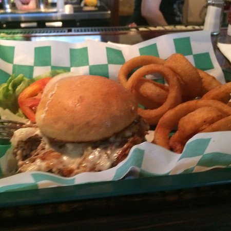 The Celtic Pub : Roasted pork sandwich with side of onion rings. House dipping sauce for rings very good.