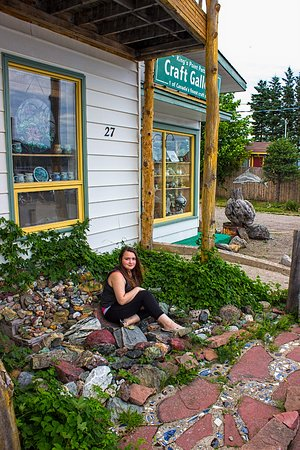 King's Point Pottery: Grand Daughter posing for a photo outside. She purchased a Sea Glass Ring for herself.