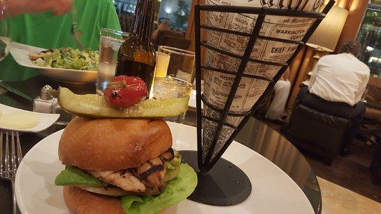 Restaurant's thick chicken dinner sandwich with a wire