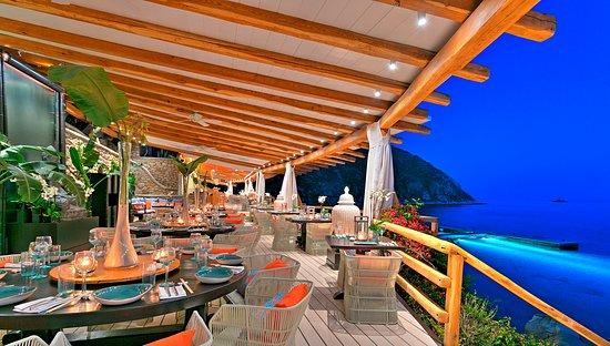 Photo of Japanese Restaurant Buddha Bar Beach at Παραλία Ορνός, Ornos 846 00, Greece