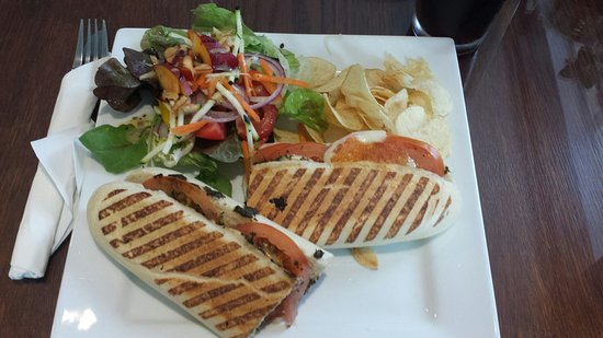 Aberchalder, UK: Tomato, mozzarella, and pesto panini with a side salad.