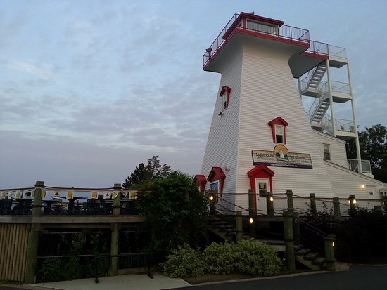Lighthouse on the Green: Lighthouse and Summer Patio Setup