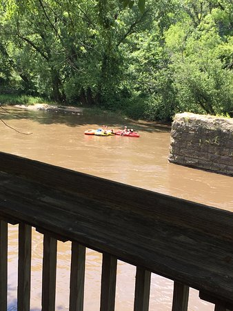 Anamosa, IA: Outdoor seating area overlooking the Wapsi River watching the tubers go by