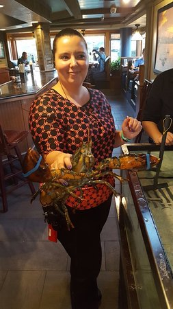 La Mesa, CA: Red Lobster Manager with a Live Lobster