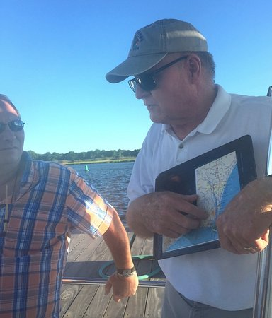 Southport, NC: Captain Tom orienting us to our waterfront location.