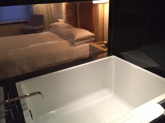 Andaz Wall Street: Interesting bathroom with a window view of the bedroom. Would be awkward if with friends.