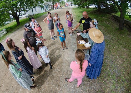 Sherbrooke, Canada : A demonstration of the making of strawberry ice cream where the visitors can help make it.